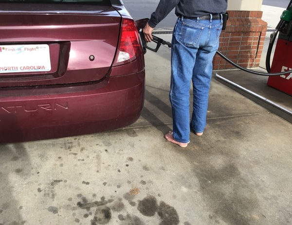 Residual oil and gas at gas pumps are unlikely to absorb into skin of bare feet