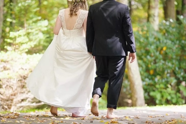 Being barefoot at a wedding is fun and natural.