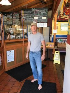 Barefoot in a restaurant. Most enlightened businesses respect a customer's choice to live barefoot.